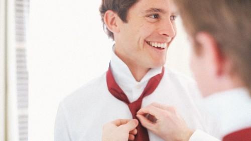 Groom Tieing Tie