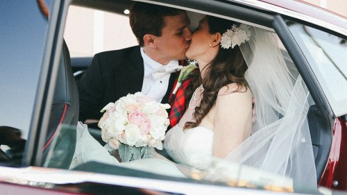 Bride and Groom kiss in Tesla
