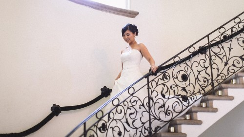 Bride on ornate staircase