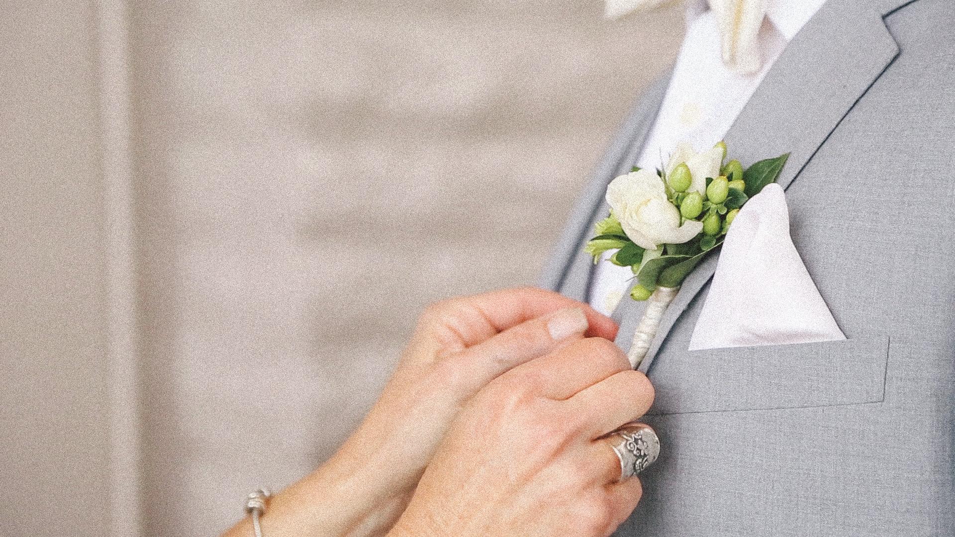 Bride pins on Groom's flower