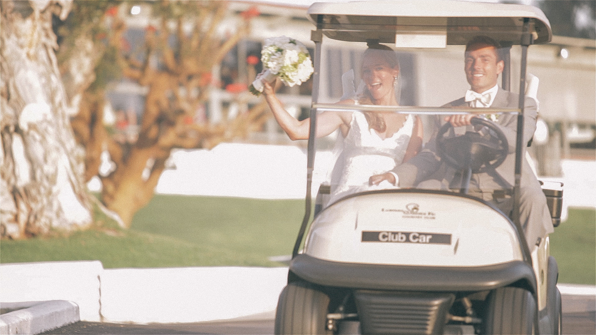 Bride & Groom in Golf Cart