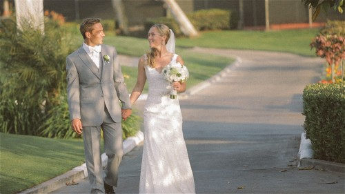 Bride and groom walking at Lomas Santa Fe Country Club