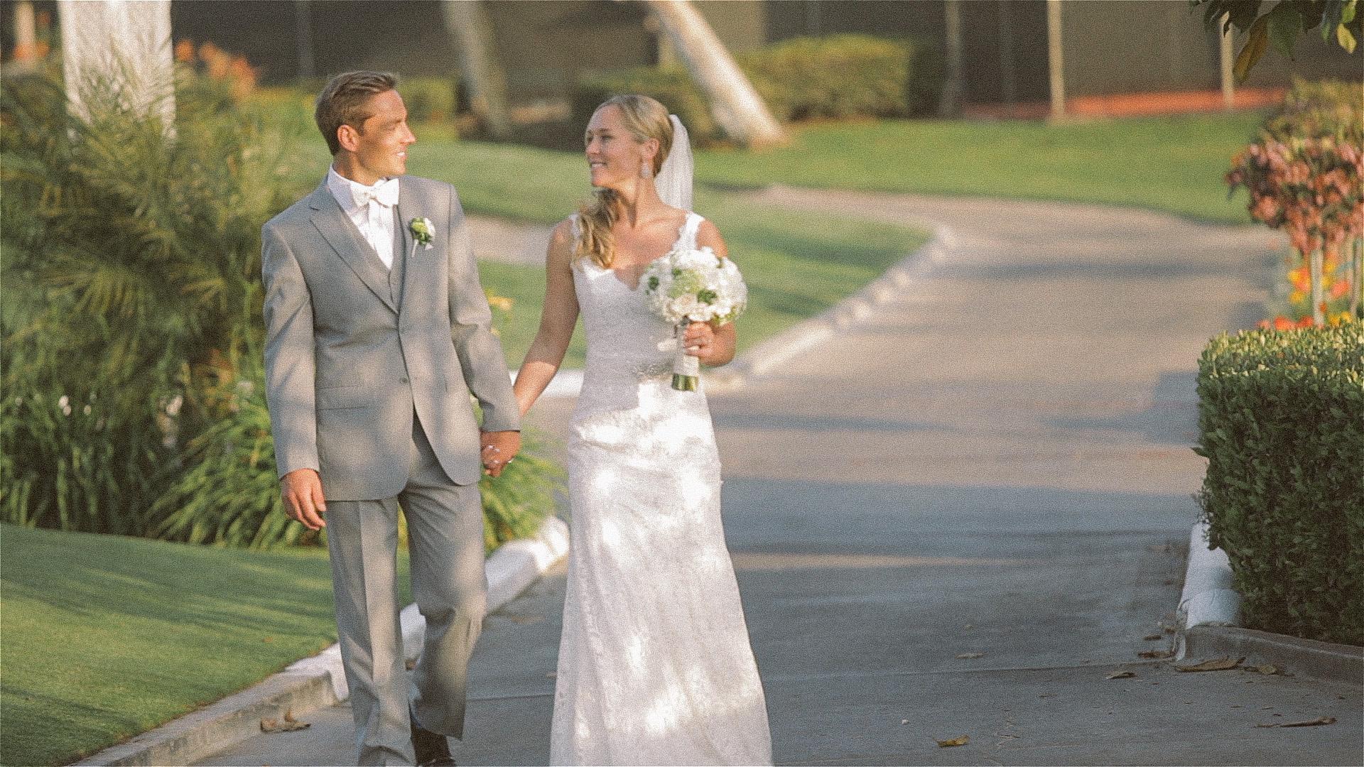 Bride and groom walking at Lomas Santa Fe Country Club