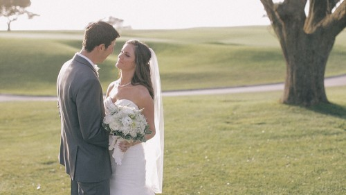 Bride and groom on golf course wedding