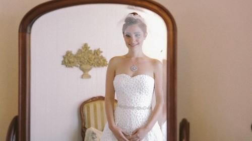 Bride looks in mirror at Calamigos