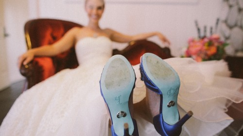 Bride with I Do on bottom of shoes