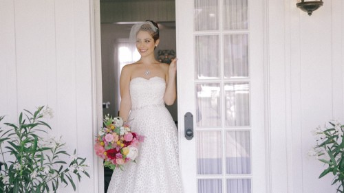 Bride with bouquet in doorway