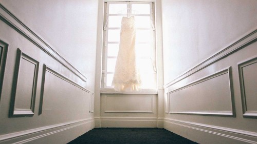 Wedding dress hanging in hallway
