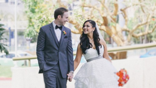 Bride and groom walking at Marriott Marquis San Diego Marina