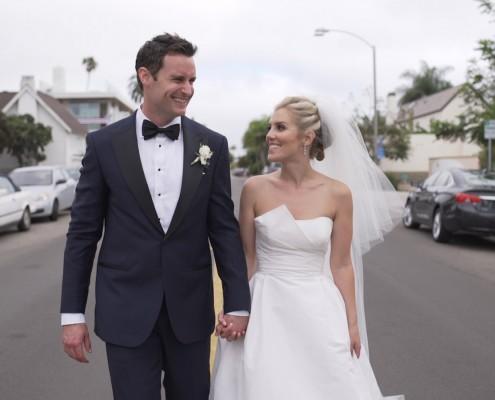 Bride and groom walk down street la jolla