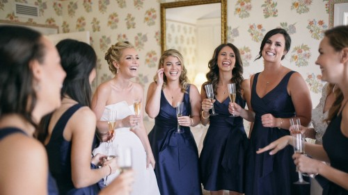 Bride and bridesmaids laughing toast Darlington house