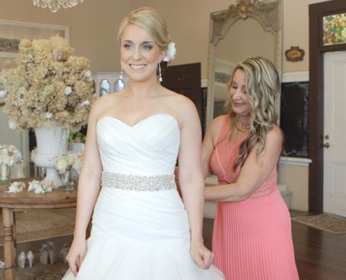 Bride putting on wedding dress San Diego Wedding Video at Twin Oaks Gardens and Estate