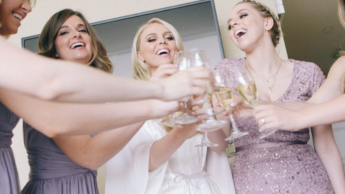 Brides maids toast champagne