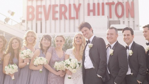 Bridal party and Beverly Hilton Sign