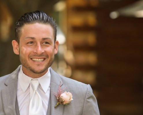Excited groom first look at Lake Oak Meadows Wedding in temecula wine country