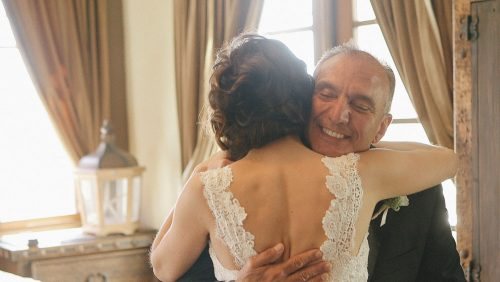 Bride and Dad hug.