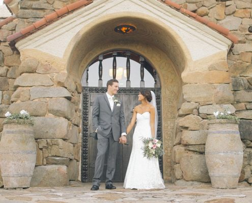 Bride and groom in front of Mt Woodson