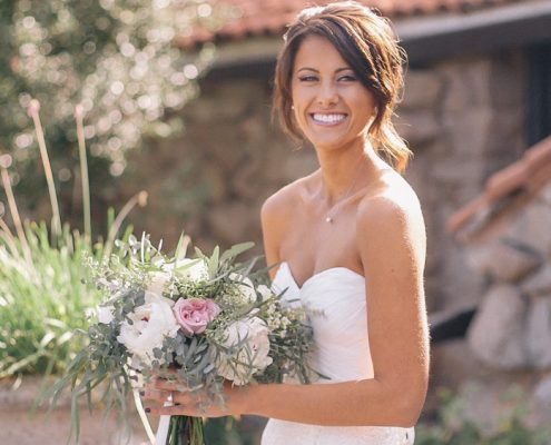 Bride with bouquet at Bride and groom ceremony Mt Woodson Castle