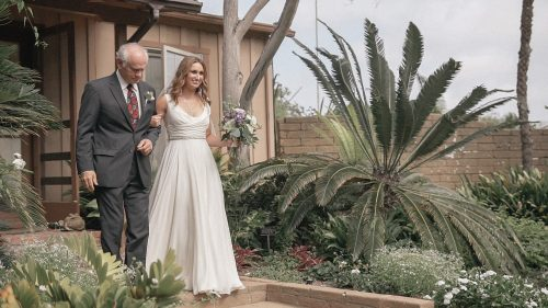 Bride walking down the aisle at San Diego Botanical Gardens wedding video.