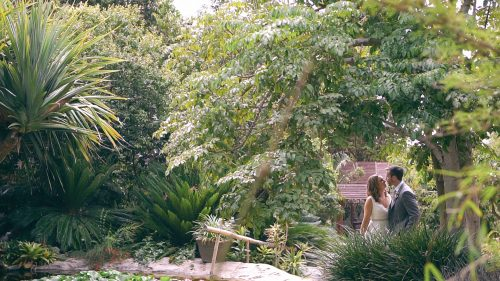 bride and groom by pond at San Diego Botanical Gardens