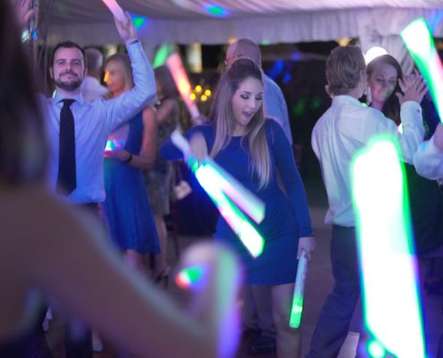 dancing at wedding reception with glow sticks