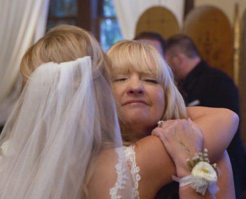 Mom and bride hug after wedding