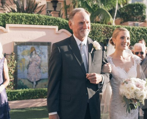 Bride walks down the aisle with dad at La Valencia Hotel