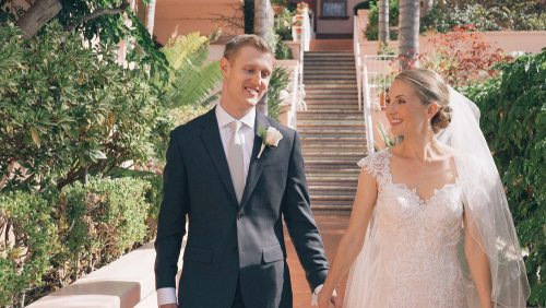 Bride and groom walk at La Valencia