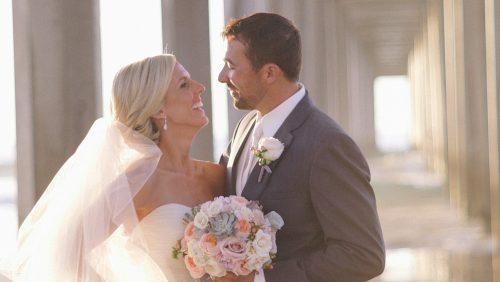 Scripps Seaside Forum bride and groom under the pier