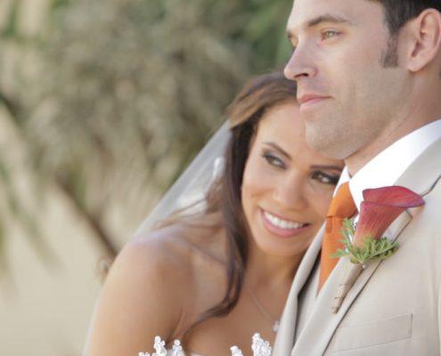 Scripps Seaside Forum bride and groom walk on beach