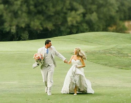 Temecula Creek Inn Wedding Bride and groom runnning
