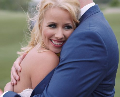 Crossings at Carlsbad wedding Groom holds bride on golf course