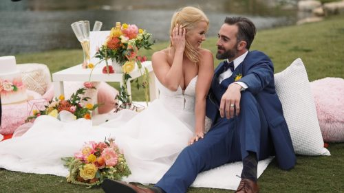 Crossings at Carlsbad wedding video bride and groom sitting on wedding decor