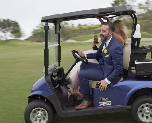 Crossings at Carlsbad bride and groom in golf cart