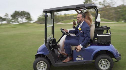 Crossings at Carlsbad bride and groom in golf cart