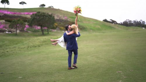 Crossings at Carlsbad wedding video bride holds bouquet in the air