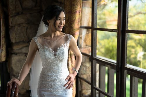 Bride looking out window San Diego wedding video