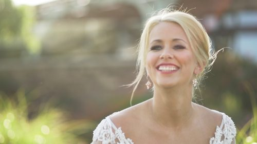 Beautiful Bride posing for portraits in sunlight for wedding video