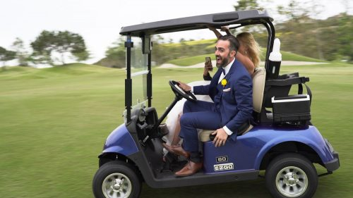 Bride and groom wild golf cart ride