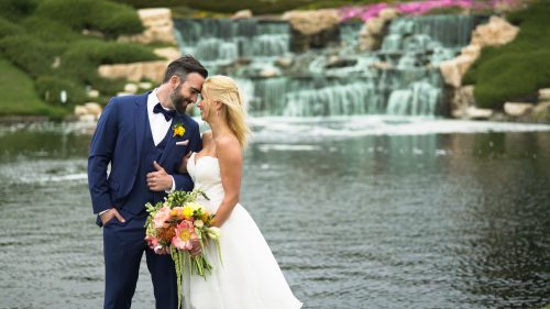 Bride and groom in front of waterfal