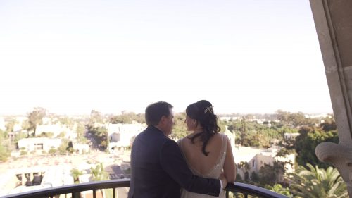 bride and groom at the top of the tower of the Museum of Man in Balboa Park looking out over San Diego
