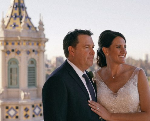 bride and groom at the top of the tower of the Museum of Man in Balboa Park San Diego