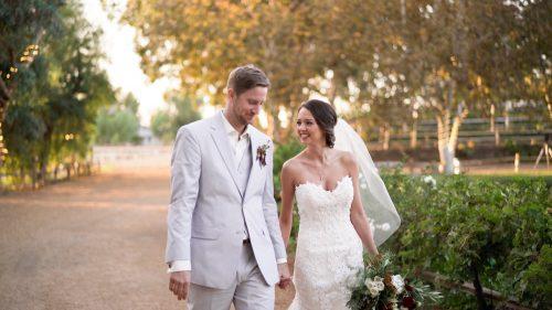 Bride and groom walking at Lake Oak Meadows in Temecula.