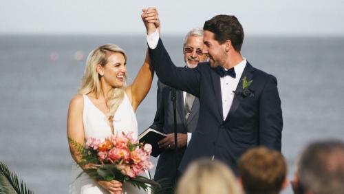 Bride and groom go down the aisle wedding surfrider beach